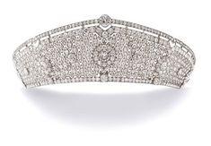 The tiara below called Pole-Carew tiara has kokoshnik shape from circa 1922 and made by Cartier. The tiara has quadrilobe motifs and set throughout with cushion-shaped diamonds, mounted in platinum.