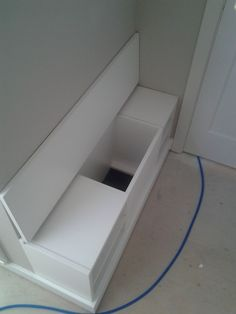 Shoe Bench with a flip top to a laundry chute.