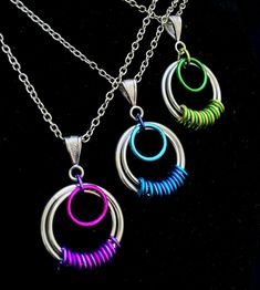 These colorful Serenity Chainmaille Pendants are handcrafted from top quality bright and anodized aluminum jump rings. Pendant measures 1 in diameter and comes with an 18 aluminum chain with a lobster clasp. __________________________________________________________________________________________ ~COLOR OPTIONS~ -Green (Picture 2) -Blue (Picture 3) -Purple (Picture 4) __________________________________________________________________________________________ ~MATCHING ITEMS~ Earrings…