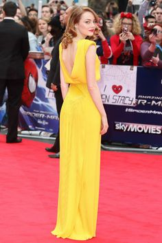 The always elegant Emma shone on the red carpet of the world premier of Spiderman 2 in a canary yellow Versace masterpiece. Image: Getty