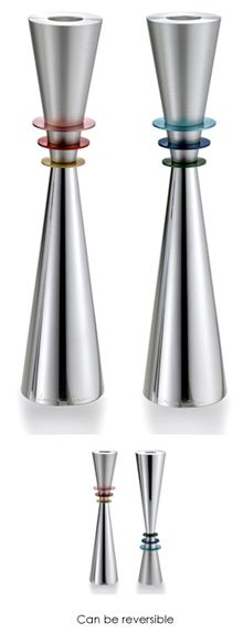 The ultimate wedding gift -- heirloom quality Shabbat Candlesticks: stunning and meaningful. This elegant pair of candlesticks represents Adam and Eve. Each piece is patiently and expertly turned from solid aviation quality aluminum. The base is then highly polished to a mirror finish and the top anodized. The contrasting finishes reflect the opposites of day and night, heaven and earth, sea and land. The six discs represent the 6 days of the week prior to Shabbat.