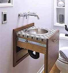 even though it reduces space inside the bathroom, it still takes up space in the walls!