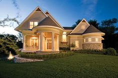 Oval shaped covered porch adds appeal  to this 5 bedroom Country style home.  Country House Plan # 101195.