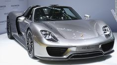 """Porsche has unveiled its high-end take on green vehicle production with its Spyder 918, a limited edition hybrid which costs over $1 million. """"Super fast and green? How the new breed of sports cars is getting a makeover""""#automobile #EV #cleantech"""