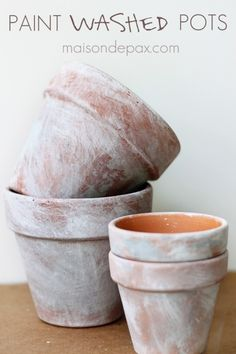 Create your own aged patina on terra cotta pots with this simple tutorial!