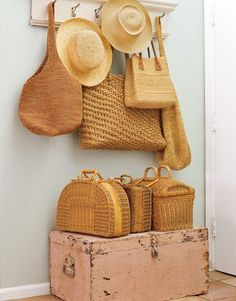We love the combination of baskets, hats, purses, and the trunk for a beautiful entryway decoration!