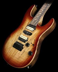 Suhr Modern in Dark Brown Burst Gloss with a Spalted Maple top and headstock veneer, 2-piece Black Limba body and neck, and a Macassar Ebony fingerboard