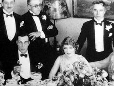 Buster Keaton, Mary Pickford, and Charlie Chaplin at a dinner party held by Joseph Schenck to welcome Rudolph Valentino into United Artists
