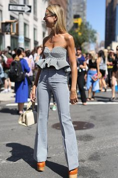 Pin for Later: All the Best Street Style From New York Fashion Week NYFW Street Style Day 4 Natalie Joos was a master at playful proportions in a peplum-trimmed bustier and flares. Best Street Style, Looks Street Style, Nyfw Street Style, Street Style Summer, Cool Street Fashion, Street Chic, Love Fashion, Fashion Looks, Womens Fashion
