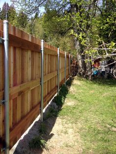 We custom make steel gate frames which prevent sagging and attach the desired wood pickets to match the fence.