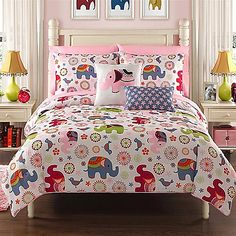 The VCNY Zoe Comforter Set will transform your bedroom into a place of fun and adventure. Featuring colorful elephants on a white ground, the comforter reverses to a pink floral print on a blue ground. Complete with sheets, shams and throw pillows.