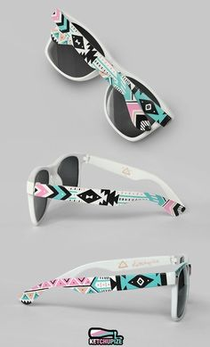 Gorgeous hand painted sunglasses with a tribal print! They feature my own design in pink, teal, black and white. These are painted on both outside ...
