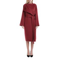 Soft burgundy cashmere for a luxurious winter. This piece has a loose, slightly oversized silhouette and wraparound fastening with matching belt. This piece is finished without fastenings can be layered over everything from cozy knits to tailoring.   Burgundy Pure Cashmere 100% cashmere, 100% silk lining Fluid textil DRY CLEAN ONLY The model is 176 cm tall and is wearing a size 36. If you need this product made to fit your needs and measures, book an appointment in our studio at i@laur...