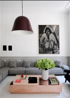 copper coffee table, grey sofa, huge pendant lamp