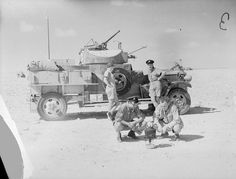 The crew of a Fordson Armoured Car of No. 2 Armoured Car Company RAF boil a kettle on a spirit stove for a 'brew up' during a halt while on patrol in the Western Desert.
