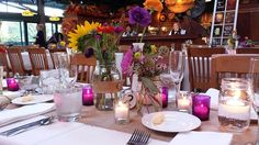 Love the use of fushia votives for this wedding within Greenfield Village's Taste of History