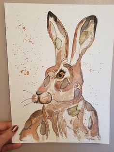 """This unframed handsome chap has been created on 300gsm watercolour paper. I have used a mix of watercolour painting, raw edge applique with recycled fabric scraps and free motion sewing to create this original and unique artwork.    It measures 14"""" x 10"""".  See daily work and process postson Instagram @needleandstitch.uk"""