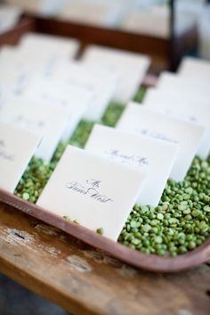 Green lentils in a copper tray for escort cards