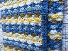 Shell stitched beach colored blanket