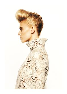 A defined, sleek, creative quiff with a braided edge, matched perfectly with a laser cut high collar top. #hairmeetwardrobe #hair #fashion