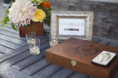 Before I Do Events texan going away party, florals, peach, yellow, orange, cigar bar, frame, cigar box, wood, votives, www.beforeidoevents.com
