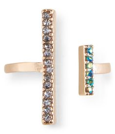 Our Pavé Double-Bar Open Ring is the perfect pick when the occasion calls for elegant accessories! It adds the perfect amount of sparkle to your digits thanks to tiny, colorful faux gems and a feminine metallic hue.<br><br>Style: 0438. Imported.