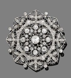 A diamond brooch, circa 1910  Of floral design, finely pierced and millegrain-set with old brilliant and single-cut diamonds, to a similarly-set diamond suspensory loop, diamonds approx. 2.90cts total, diameter 4.2cm