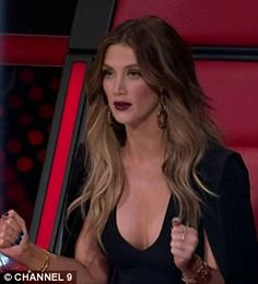 The Voice's Delta Goodrem put her assets on full display as she dressed in a plunging neckline gown while Jessie J opted for a pair of bizarre oversized hoop earrings for Monday's episode