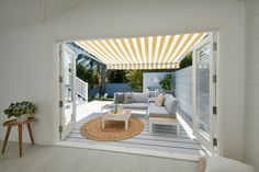 Luxaflex Folding Arm Awnings, with Dickson fabric, BS Yellow 8553 Outdoor Blinds, Outdoor Shade, Exterior Blinds, Modern Pool House, Suburban House, Small Courtyards, Outdoor Living, Outdoor Decor, Outdoor Rooms