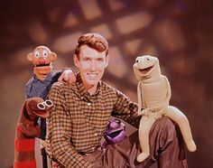 "Henson poses with characters from the TV show ""Sam and Friends,"" ca. 1956/57. From left, Harry the Hipster, Sam, Henson, Kermit and Yorick."