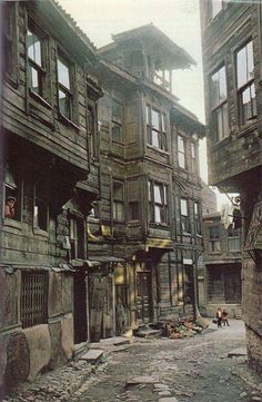 An old Istanbul street and wooden houses from the . - Sadıkin - - An old Istanbul street and wooden houses from the . National Geographic Photography, Old Street, Interesting Buildings, Le Far West, Slums, Abandoned Places, Historical Photos, Old Houses, Wooden Houses