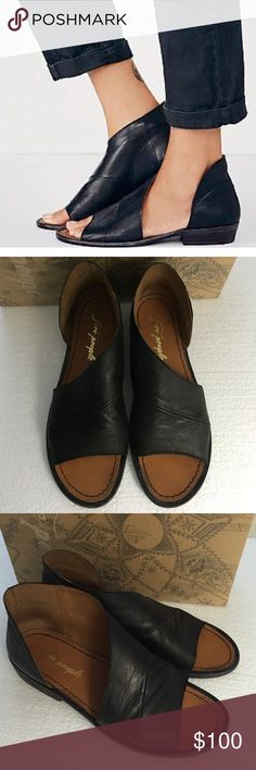 """Free People Mont Blanc black open toe sandal. These are over the top fantastic! I needed a 38. Got a 37. Too small. Already ordered a new pair. I'm in love. Coolest sexiest shoe ever. Definitely Tts. 37-7 7.5.                                              Worn 3 times. EUC. An asymmetrical strap sweeps the vamp of an open-toe sandal to enhance the silhouette's modern design. Handcrafted in Spain from supple leather, the half-d'Orsay.  1"""" heel (size 39). 3 1/2"""" shaft. Leather upper and…"""