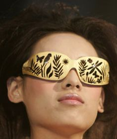 A model wears a pair of gold glasses, which weigh 111.33 grams and are designed by Chinese designer Zhu Fei, during a gold jewellery design competition in Beijing March 28, 2007.