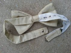 Handsome pale sandy tan bow tie with faint pattern of tiny dots and flower…