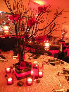 black manzanita trees, red orchids, and hanging tealights centerpiece