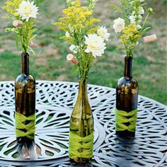 These wine bottle centerpieces from Hostess with the Mostess are AWESOME and so easy to make! What A Great Ideal For A Wine Tasting : ) Wine Bottle Vases, Wine Bottle Centerpieces, Wine Bottle Crafts, Bottles And Jars, Wedding Centerpieces, Wedding Decorations, Recycle Bottles, Empty Bottles, Festa Pin Up