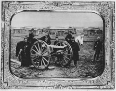 Union soldiers of the Cleveland Light Artillery posing with a cannon in an unidentified camp during the Civil War. At least three of the people in uniform appear to be women.