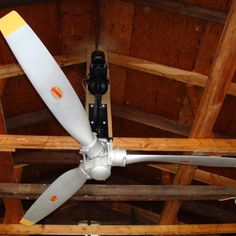 Airplane propeller ceiling fan to decorate an aviator's man cave… Airplane Ceiling Fan, Airplane Decor, Airplane Room, Wooden Airplane, Deco Aviation, Aviation Theme, Aviation Art, Aviation Furniture, Automotive Furniture