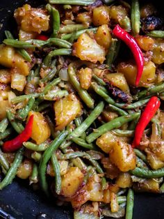 Sri Lankan spicy potato, green bean stir-fry- spicy, budget-friendly, vegan, vegetarian side-dish you can prepare to accompany any meal. Spicy Vegetarian Recipes, Vegetarian Side Dishes, Quick Vegetarian Meals, Veggie Dishes, Curry Recipes, Indian Food Recipes, Food Dishes, Vegan Recipes, Cooking Recipes