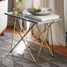 I wouldn't mind a pair of these as end tables next to my bed. Or even just one. brass geometric base legs, grey marble top - Waldorf Side Table | West Elm