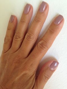 One of the best neutral nail shades to try this season is essie's mauve Lady Like