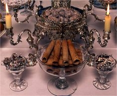 An 18th century epergne and some sweetmeat glasses filled with various items of historical chocolate confectionery, including diablotins (1755), chocolate drops (1789) and the Queen's Chocoladoes - in the central bowl of the epergne. These were candied immature cacao nuts and date from the 1660s.