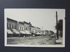 Edgerton Wisconsin WI Front Street Real Photo Postcard RPPC Signs Wagons 1908