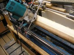 Router Lathe by Aziz Subach -- Homemade router lathe constructed from steel rods, linear bearings, a bicycle wheel, and a chain. http://www.homemadetools.net/homemade-router-lathe-4