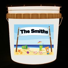 This bucket light is personalized with your family name on a banner, along with a beach scene.