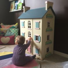 Children's Interior design: Ava playing in her room with her beautiful Dollhouse. Milka Interiors real rooms!