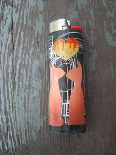 Lighters -- Orange and Green Cats in Love Bic Lighter. $5.25, via Etsy. Bic Lighter.