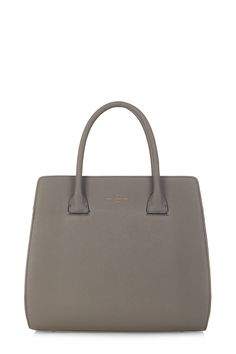 Georgia is a smart ladylike tote inspired by architectural design. In luxurious taupe, this handbag is a must have! Visit Paul's Boutique!