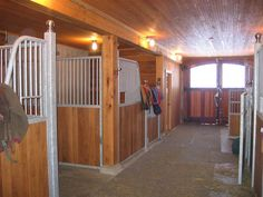 Stable interior with wood, galvanized stall equipment, and flat ceiling