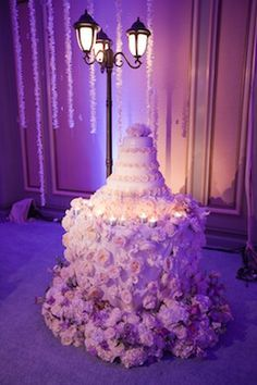 Cake table with overflowing flowers. Making the wedding cake a focal point of your receptions is a great idea!    #wedding #cake #love #marriage